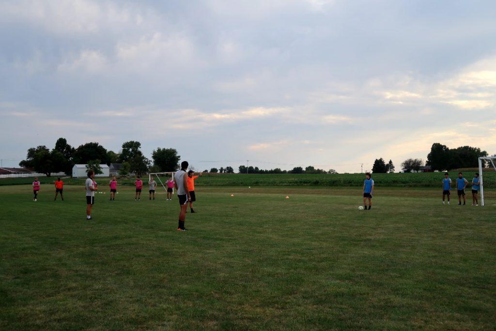 Soccer team going through drills. Media by Jose Soutullo