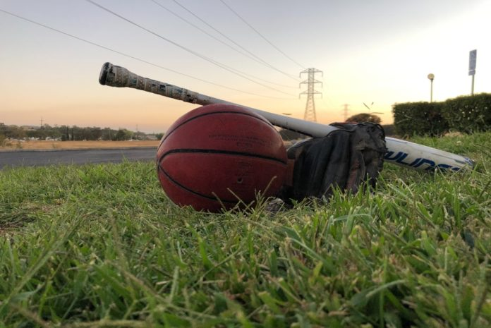 Baseball glove and bat with a basketball