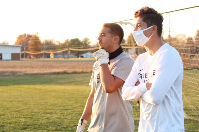 Coach Arriaga and Damian Garcia. Media by Wyatt Moser